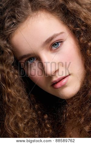 Beauty Portrait Teenage Female Fashion Model With Curly Hair