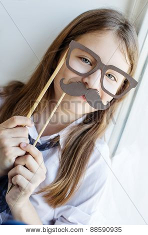 Portrait Of A Schoolgirl In Funny Glasses