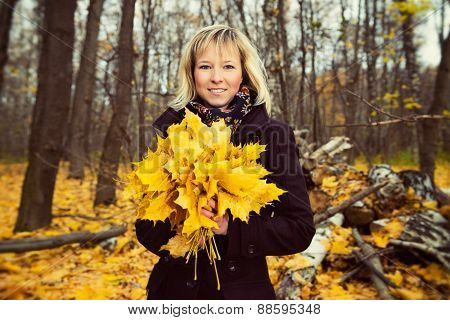 Autumn portrait of a beautiful young woman