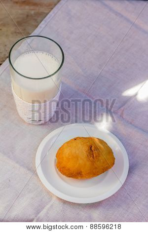 pirozhki, russian traditional food, with glass of milk, Meat patties in the plate, vegetable pasties, buns