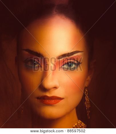 Close Up Stylized Portrait Of A Japanese Geisha With Bright Make Up Standing At The Window