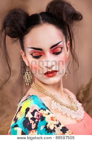 Stylized Portrait Of A Japanese Geisha With Bright Make Up