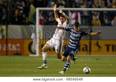 CARSON, CA. - APR 18: Servando Carrasco & Alan Gordon (L) in action during the L.A. Galaxy game against Sporting Kansas City on April 18, 2015 at the StubHub Center in Carson, California.