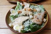 foto of caesar salad  - Chicken salad Romano white savory croutons quail eggs sauce Caesar and parmesan cheese - JPG