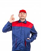 stock photo of overalls  - Man in blue and red overalls - JPG