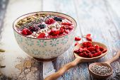 foto of sunflower  - Breakfast berry smoothie bowl topped with goji berries - JPG