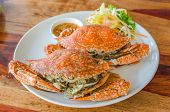 picture of cooked crab  - Two Stream Crabs one white dish and wood table - JPG