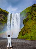 picture of waterfalls  - Grand waterfall with rainbow in the water mist Skogafoss - JPG
