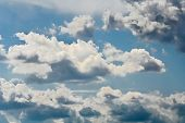 picture of cumulus-clouds  - Picturesque gray cumulus clouds in the blue sky on a summer day - JPG