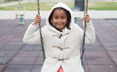 picture of swing  - Outdoor portrait of a cute young black girl playing with a swing  - JPG