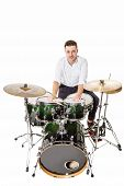 foto of drum-kit  - Handsome guy behind the drum kit on a white background in shirt and trousers - JPG