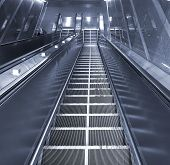 picture of escalator  - A long escalator leading into an underground passage - JPG