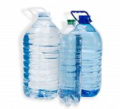stock photo of plastic bottle  - Two large plastic bottle with handles and one little bottle with drinking water on a light background - JPG