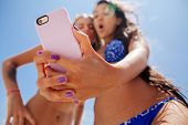 pic of two women taking cell phone  - two girls selfie smartphone camera close up on beach - JPG