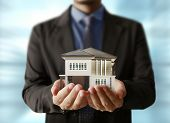 stock photo of house representatives  - holding house representing home ownership and the Real Estate business  - JPG