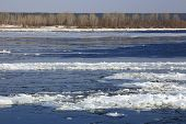 image of crevasse  - landscape ice drift on the river in the spring on a sunny day - JPG