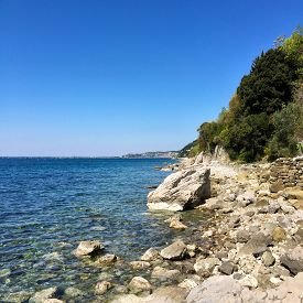 pic of naturist  - A sunny day in a Stunning Naturist Beach in Trieste Italy  - JPG
