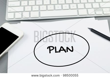 Plan buble on paper with pencil and smart phone on Computer desk