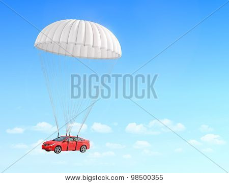 Concept Of Leasing. Fast Delivery Car. Red Car Falling On The Parachute On A Sky Background.