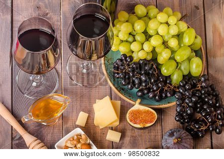 Grape And Cheese Variety With A Red Wine