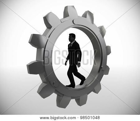 Executive worker walking inside a gear.