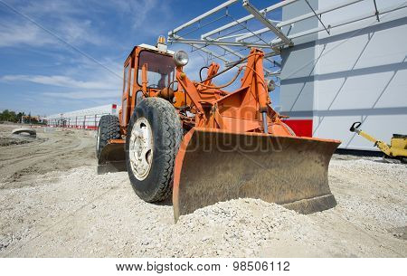 Grader At Building Site