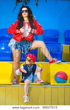 Rapper attitude rap singer hip Hop Dancer performing. Stylish woman and little boy posing holding th