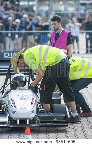 HOCKENHEIM, GERMANY - AUGUST 2, 2015: Officials and Scrutineers check the safety and regulations of the FS Team Delft car, prior to the start of the endurance race of the officious world championships