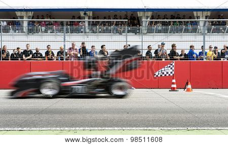 HOCKENHEIM, GERMANY - AUGUST 1, 2015: Formula Student team from the University of Coburg crosses the finish line of the accelleration trial during the world championships in the Combustion class