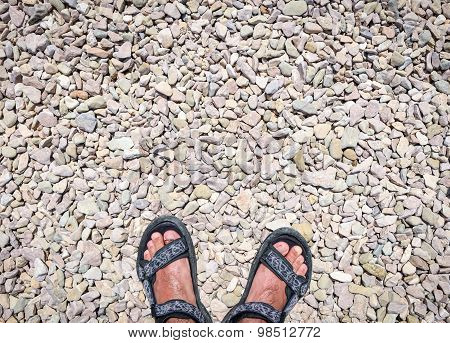 Traveler's Feet On Stone Paved Road Wearing Sandals