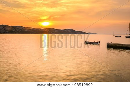 Peaceful Sunset By The Sea With Boats And Sailship