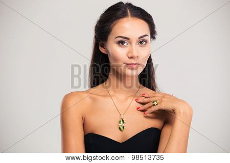 Jewelry concept. Gorgeous female model looking at camera isolated on a white background