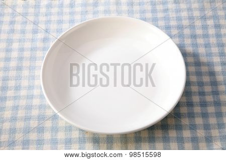 white plate isolated on table cloth