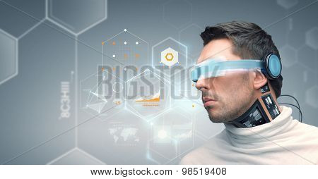 people, technology, future and progress - man with futuristic glasses and microchip implant or sensors over gray background with virtual charts and chemical formulas
