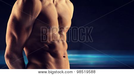 sport, bodybuilding, strength and people concept - close up of male bodybuilder bare torso over dark background