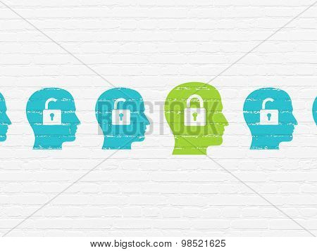 Safety concept: head with padlock icon on wall background