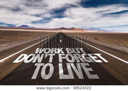 Work But Don't Forget to Live written on desert road