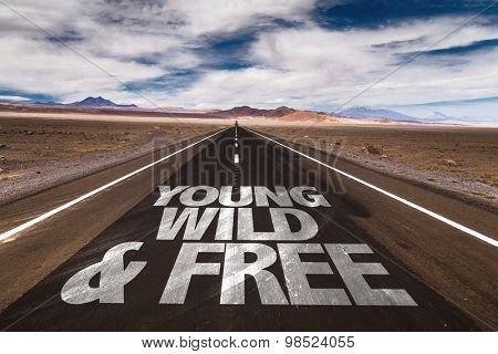 Young Wild & Free written on desert road
