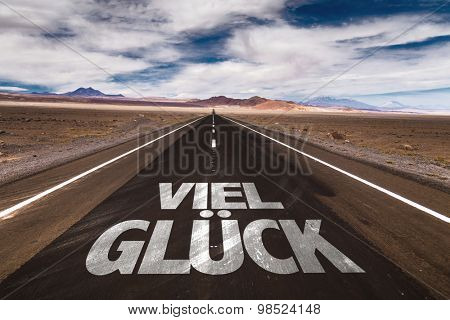 Good Luck (in German) written on desert road