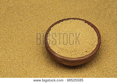 white millet in a wooden dish