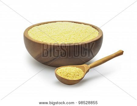white millet in a wooden bowl