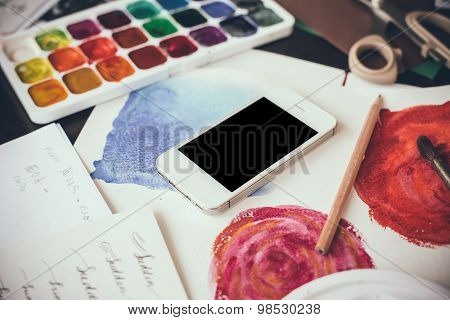 Smartphone on a table in the artist studio