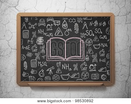 Science concept: Book on School Board background