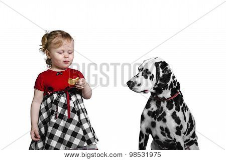 Little Girl Eats Cookies And Teases Dalmatian Dog