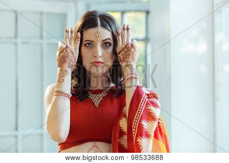 Indian picture on woman hands, mehendi tradition decoration