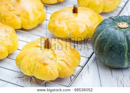 Fresh Homemade Pumpkin Buns On A Cooling Rack