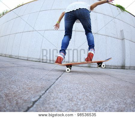 closeup of young woman skateboard practice outdoor