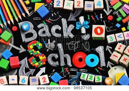 School supplies on black schoolboard background