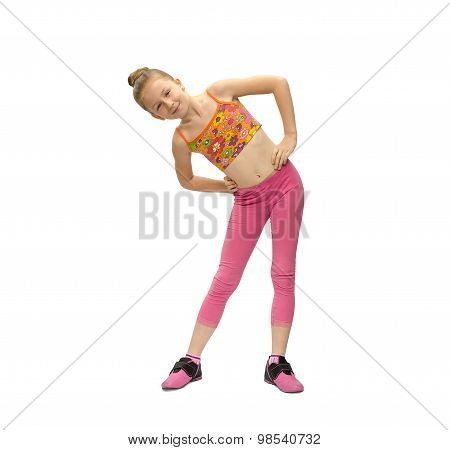 Little Girl Does Exercises On A White Background