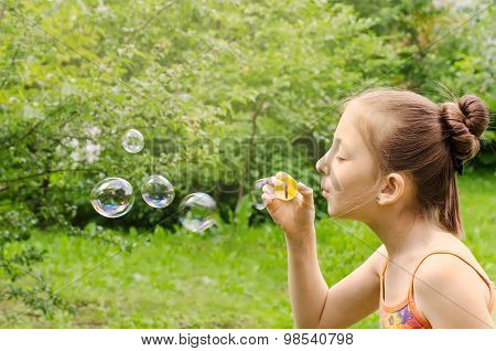 Portrait Of The Girl Who Are Starting Up Soap Bubbles